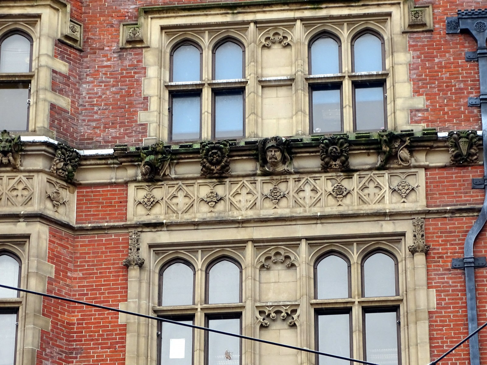 Pawson & Brailsford Facade High Street carving by the Tory Family.jpg