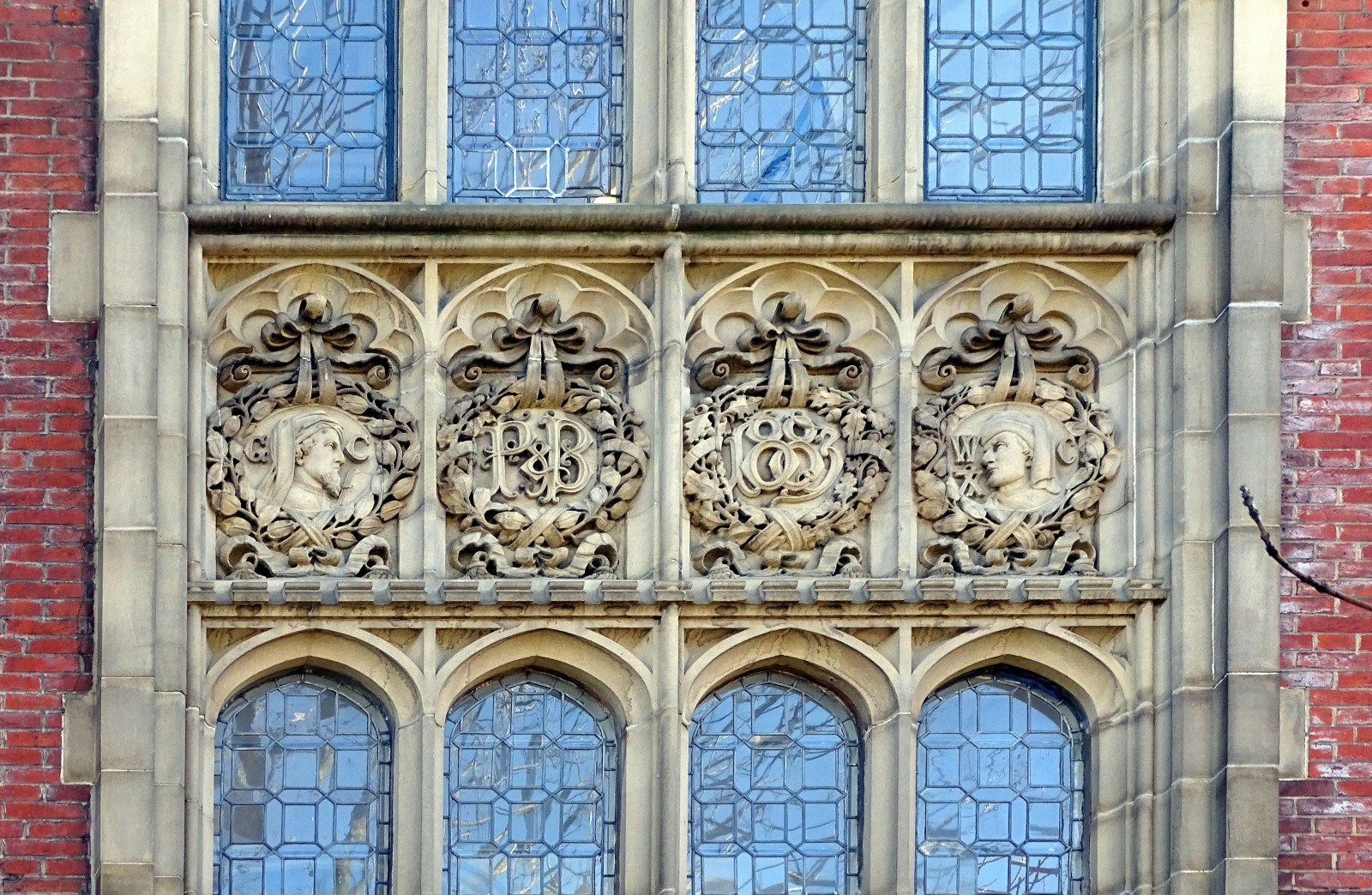 Carved Frieze by the Tory Family on Pawson & Brailsfords building on East Parade featuring Geofrey Chaucer & William Caxton.jpg