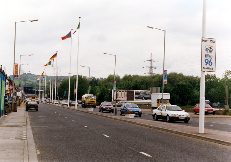 Penistone Road with the flags from the 1966 World Cup games