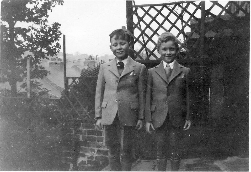 john with phillip nicholas whit 1950 in our new clothes.jpg